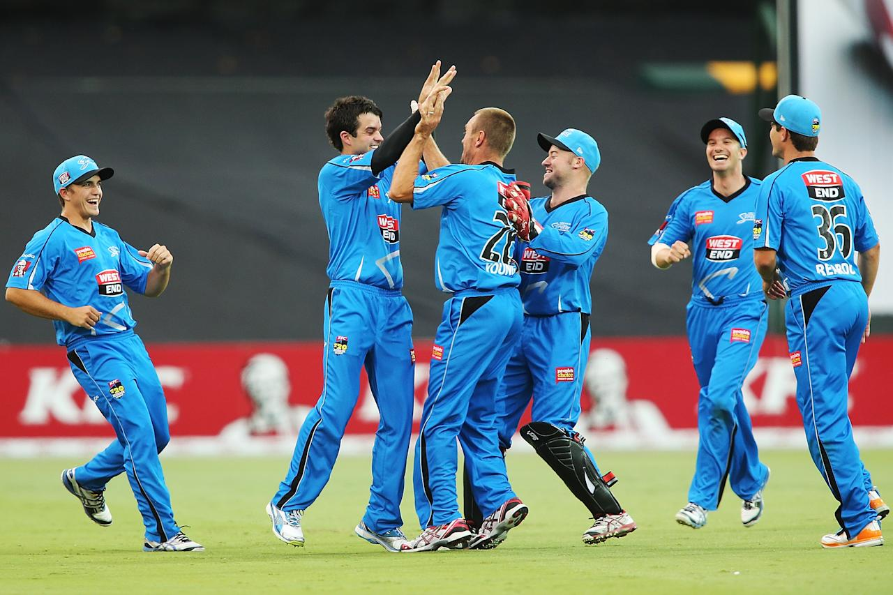 ADELAIDE, AUSTRALIA - DECEMBER 23: Callum Ferguson of the Strikers celebrates with team-mates after his catch dismissed Daniel Smith of the Sixers  during the Big Bash League match between the Adelaide Strikers and the Sydney Sixers at Adelaide Oval on December 23, 2012 in Adelaide, Australia.  (Photo by Morne de Klerk/Getty Images)