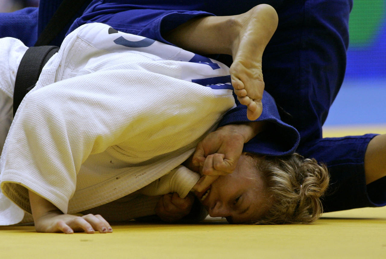 United States' Kayla Harrison fights with Cuba's Yelennis Castillo, dressing a blue kimono, in their women's -78kg category semifinal match during the World Cup of Judo in Sao Paulo, Sunday, May 30, 2010. (AP Photo/Nelson Antoine)