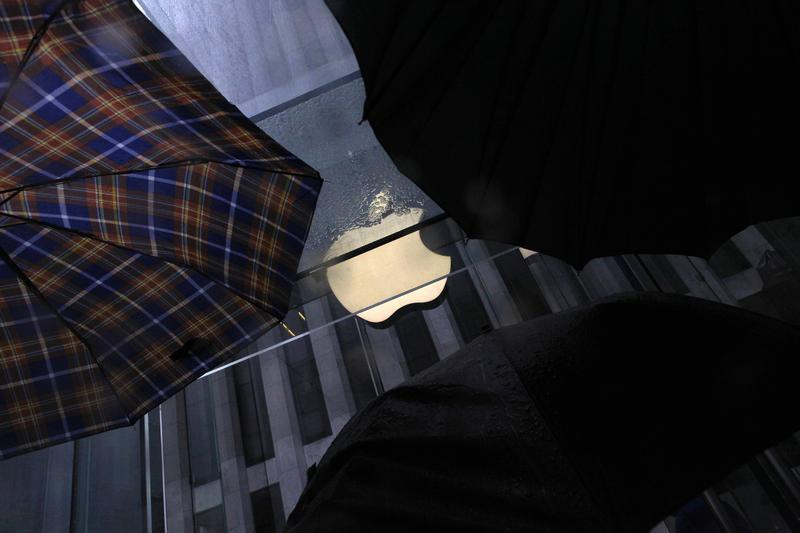 Umbrellas are seen in front of the Apple store on 5th Avenue in New York