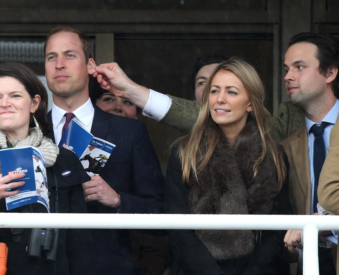 CHELTENHAM, ENGLAND - MARCH 15:  Prince William, Duke of Cambridge has his ear pulled by a friend as Catherine, Duchess of Cambridge looks on on day 4 of the Cheltenham Festival at Cheltenham Racecourse on March 15, 2013 in Cheltenham, England.  (Photo by Danny Martindale/Getty Images)