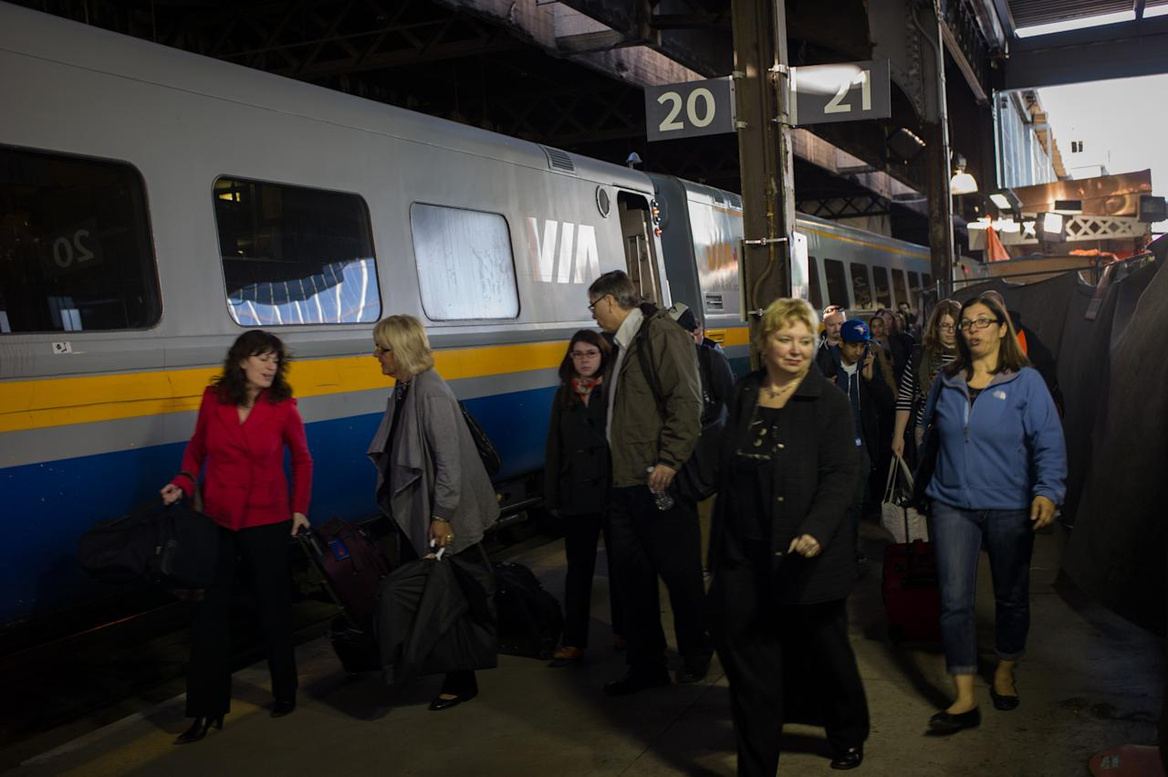 TORONTO, CANADA -  APRIL 22:  Commuters leave a VIA Rail train at Union Station, the heart of VIA Rail travel, on April 22, 2013 in Toronto, Ontario, Canada. The Royal Canadian Mounted Police (RCMP) report they have arrested two people connected to an alleged Al Qaeda plot to detonate a bomb on a VIA Rail train in Canada.  (Photo by Ian Willms/Getty Images)
