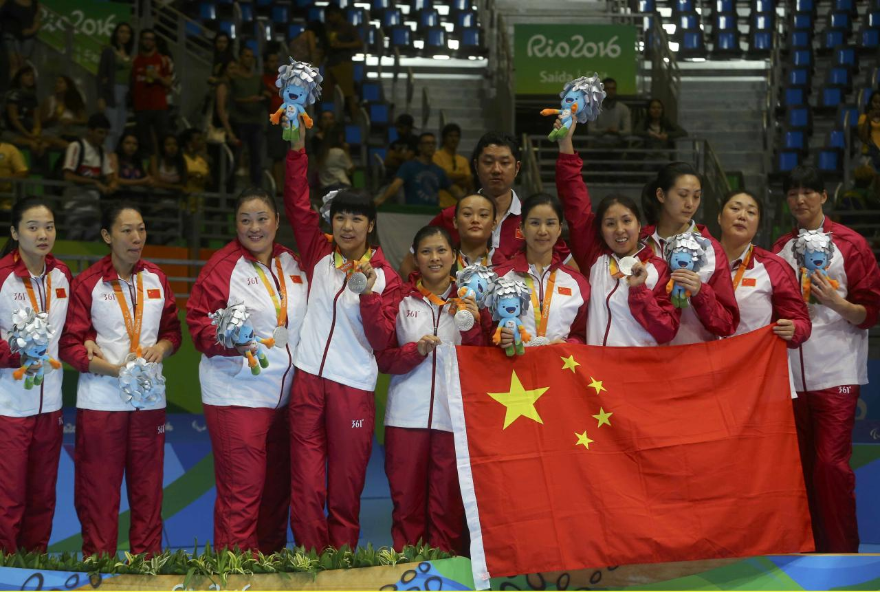 2016 Rio Paralympics - Sitting Volleyball - Victory Ceremony - Women's Gold Medal Match - Riocentro Pavilion 6 - Rio de Janeiro, Brazil, 17/09/2016. Members of team China pose during the medal ceremony.  REUTERS/Pilar Olivares FOR EDITORIAL USE ONLY. NOT FOR SALE FOR MARKETING OR ADVERTISING CAMPAIGNS.
