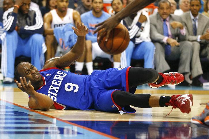 Philadelphia 76ers guard James Anderson (9) reacts as he looses control of the ball against the Charlotte Bobcats during the second half of an NBA basketball game in Charlotte, N.C., Saturday, April 12, 2014