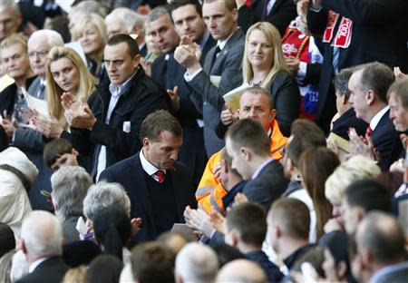 Liverpool manager Brendan Rodgers is applauded during a memorial service to mark the 25th anniversary of the Hillsborough disaster at Anfield in Liverpool