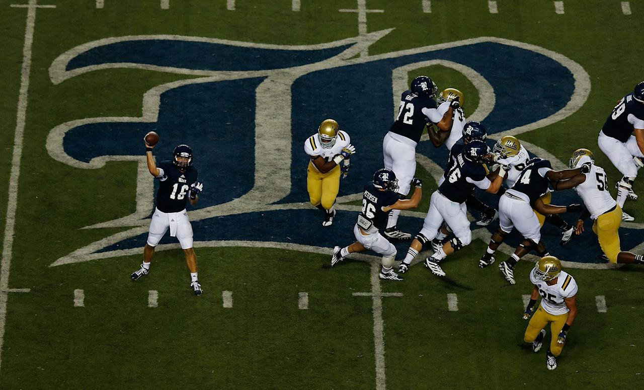 HOUSTON, TX - AUGUST 30:  Taylor McHargue #15 of the Rice Owls throws a pass against the UCLA Bruins during their game at Rice Stadium on August 30, 2012 in Houston, Texas.  (Photo by Scott Halleran/Getty Images)