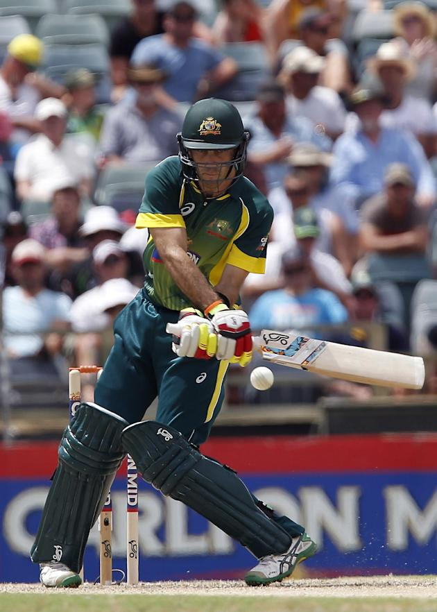 Glen Maxwell plays a switch-hit off Chris Woakes for four over thirdman. (AP Photo/Theron Kirkman)