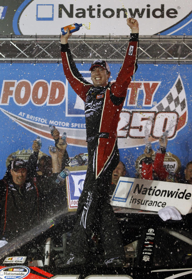 Kyle Busch celebrates after winning the NASCAR Nationwide Series Food City 250 auto race on Friday, Aug. 26, 2011, in Bristol, Tenn. (AP Photo/Wade Payne)