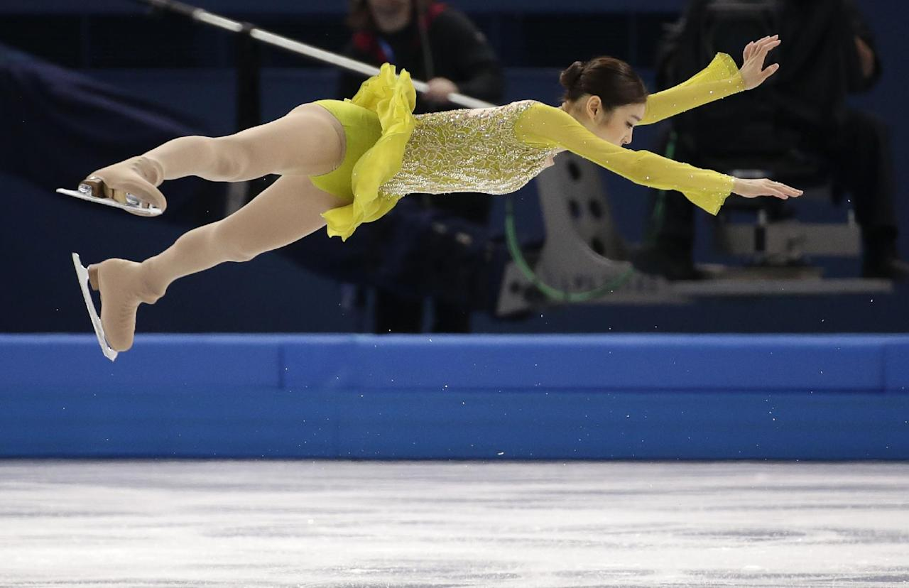 Yuna Kim of South Korea competes in the women's short program figure skating competition at the Iceberg Skating Palace during the 2014 Winter Olympics, Wednesday, Feb. 19, 2014, in Sochi, Russia. (AP Photo/Bernat Armangue)