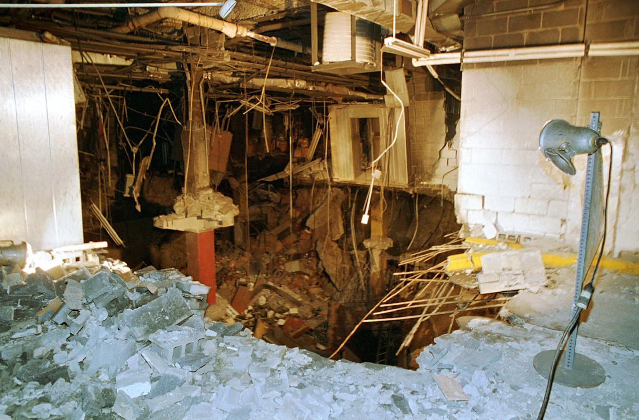 FILE - In this file photo of Feb. 27, 1993, a crater is exposed in an underground parking garage of New York's World Trade Center the day after an explosion tore through it. Twenty years ago a group of terrorists blew up explosives under one of the towers, killing six people and ushering in an era of terrorism on American soil.(AP Photo/Richard Drew, File)