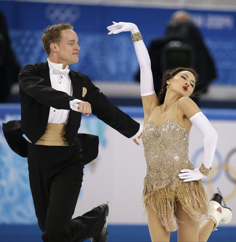 Madison Chock and Evan Bates of the United States compete in the ice dance short dance figure skating competition at the Iceberg Skating Palace during the 2014 Winter Olympics, Sunday, Feb. 16, 2014, in Sochi, Russia. (AP Photo/Darron Cummings)