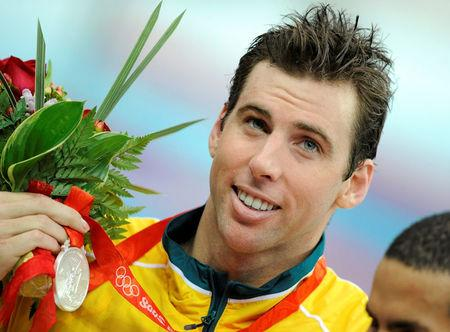 FILE PHOTO - Grant Hackett of Australia holds his silver medal for the men's 1500m freestyle swimming final at the National Aquatics Center during the Beijing 2008 Olympic Games