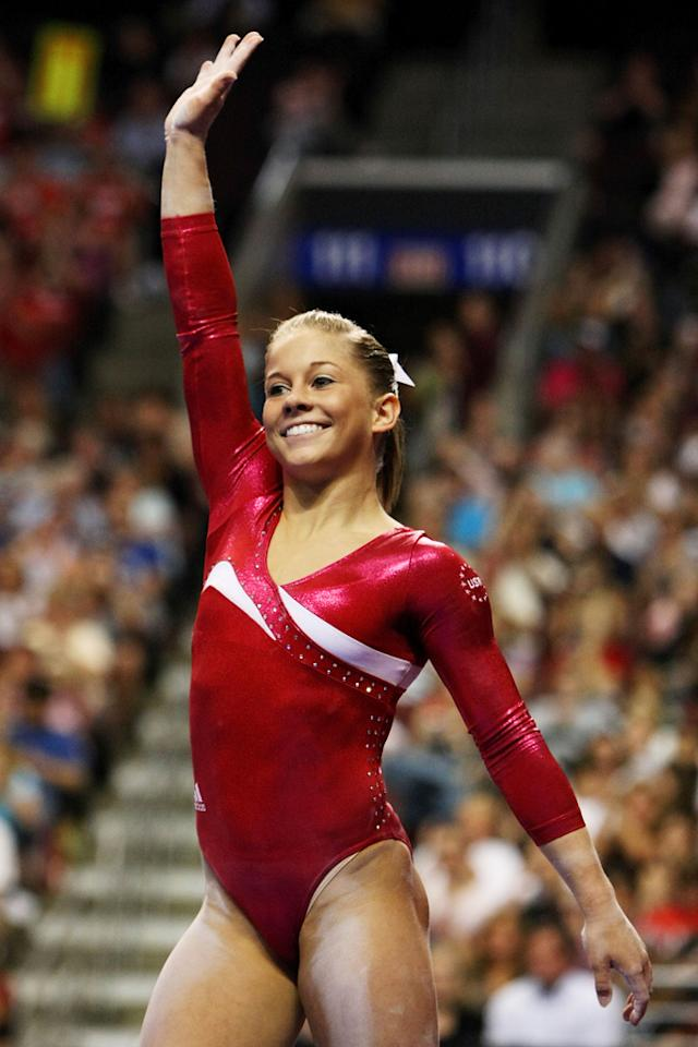 Shawn Johnson waves to the crowd after competing on the balance beam during day two of the 2008 U.S. Olympic Team Trials for gymnastics at the Wachovia Center on June 20, 2008 in Philadelphia, Pennsyvania.