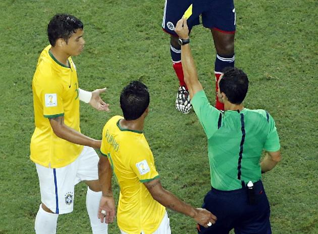 Brazil's Thiago Silva gets a yellow card during the World Cup quarterfinal soccer match between Brazil and Colombia at the Arena Castelao in Fortaleza, Brazil, Friday, July 4, 2014. (AP Photo/Fabrizio Bensch, pool)