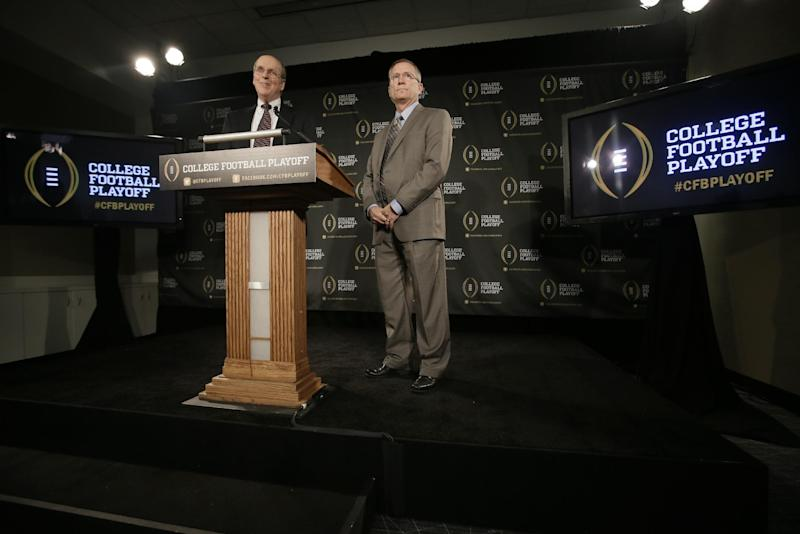 Bowl Championship Series executive director Bill Hancock, left, and Arkansas athletic director Jeff Long, chairman of the College Football Playoff Committee, announce the 12 members selected to the committee during a news conference, Wednesday, Oct. 16, 2013, in Irving, Texas. Former Secretary of State Condoleezza Rice, former Nebraska coach Tom Osborne and College Football Hall of Fame quarterback Archie Manning and Long are among the 13 people who will be part of the College Football Playoff selection committee in 2014