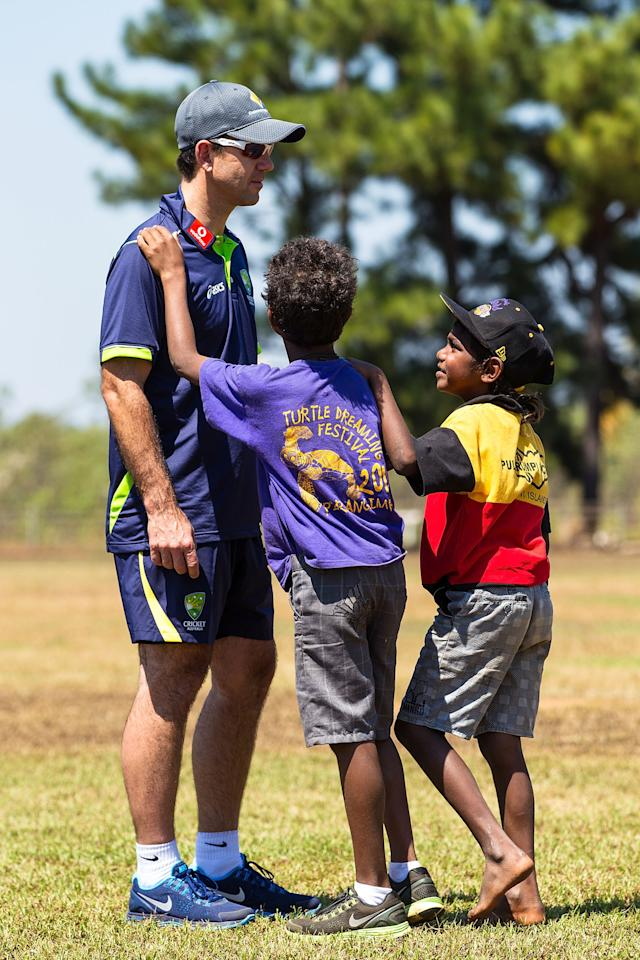 DARWIN, AUSTRALIA - AUGUST 10:  Ricky Ponting of the Australian cricket team greets locals during a visit to Pirlangimpi of the Tiwi Islands on August 10, 2012 on the Tiwi Islands, Australia.  (Photo by Mark Nolan/Getty Images)