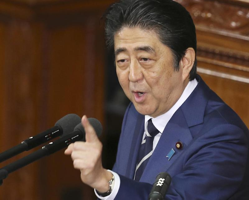 FILE - In this Friday, Jan. 20, 2017 file photo, Japanese Prime Minister Shinzo Abe delivers his policy speech during a Diet session at the lower house of parliament in Tokyo.  Japanese media reports say Prime Minister Shinzo Abe plans to propose a major economic cooperation initiative meant to create hundreds of thousands of jobs in the U.S. when he meets with President Donald Trump later this month. Abe and Trump are expected to meet on Feb. 10.(AP Photo/Koji Sasahara, File)