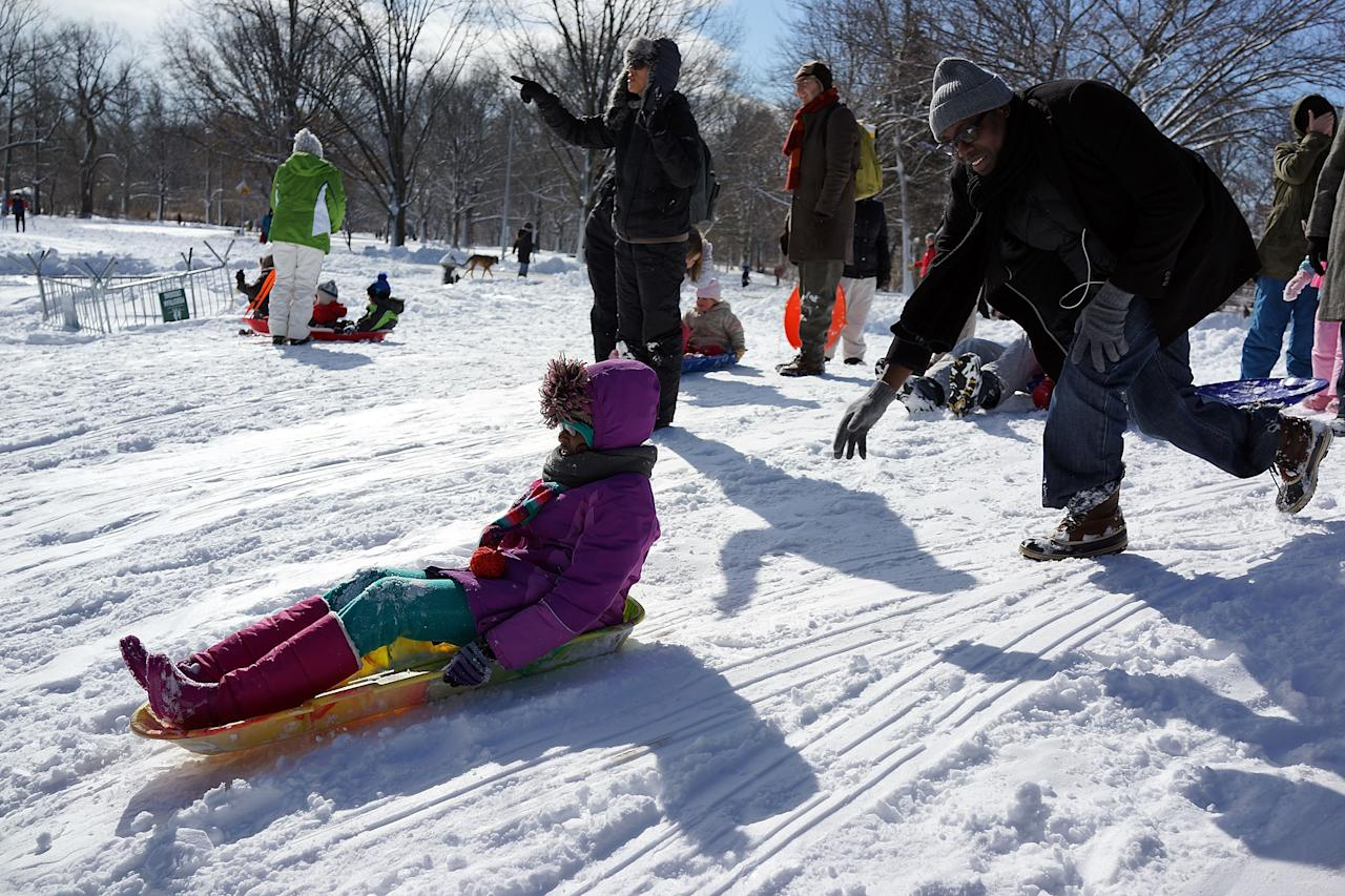 NEW YORK, NY - FEBRUARY 09:  Children sled in Prospect Park in Brooklyn the morning after a massive snow storm on February 9, 2013 in New York City. New Yorkers woke up to over 10 inches of snow Saturday morning  while parts of New England received over thirty inches following a storm that brought high winds and blizzard like conditions to the region.  (Photo by Spencer Platt/Getty Images)