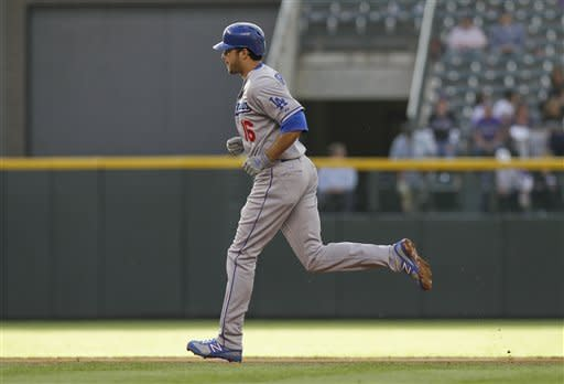 Lilly efficient in Dodgers' 7-6 win over Rockies