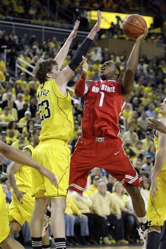 Ohio State forward Deshaun Thomas (1) shoots over Michigan forward Evan Smotrycz (23) during the second half of an NCAA college basketball game in Ann Arbor, Mich., Saturday, Feb. 18, 2012. Michigan won 56-51. (AP Photo/Carlos Osorio)