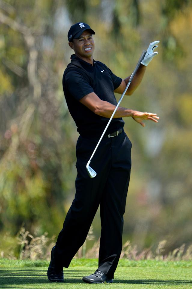 SAN FRANCISCO, CA - JUNE 15:  Tiger Woods of the United States reacts to his tee shot on the second hole during the second round of the 112th U.S. Open at The Olympic Club on June 15, 2012 in San Francisco, California.  (Photo by Stuart Franklin/Getty Images)