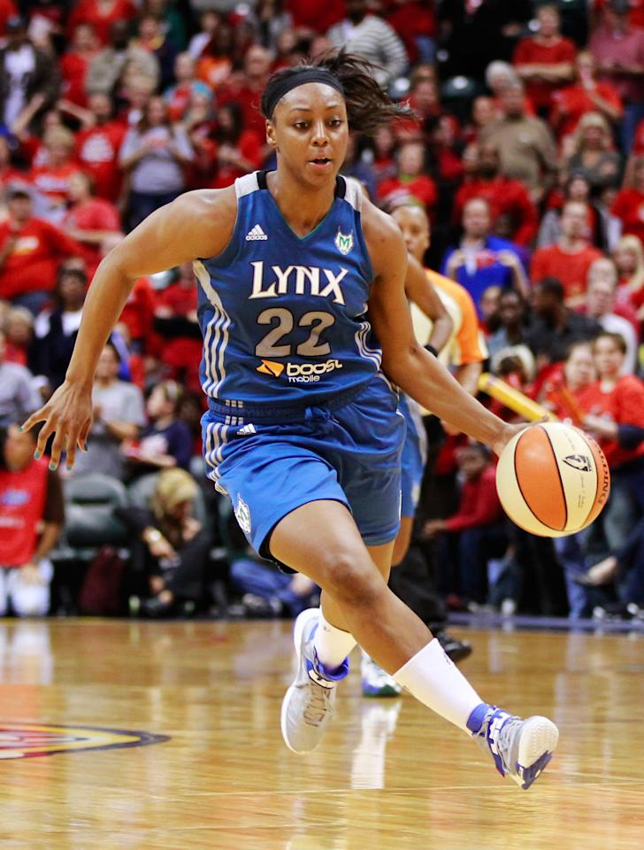 INDIANAPOLIS, IN - OCTOBER 19: Monica Wright #22 of the Minnesota Lynx dribbles up court against the Indiana Fever during Game Three of the 2012 WNBA Finals on October 19, 2012 at Bankers Life Fieldhouse in Indianapolis, Indiana. NOTE TO USER: User expressly acknowledges and agrees that, by downloading and or using this Photograph, user is consenting to the terms and conditions of the Getty Images License Agreement. (Photo by Michael Hickey/Getty Images)