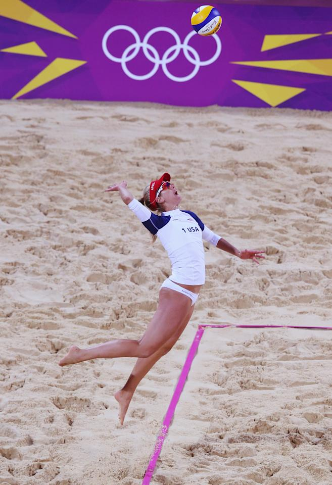 LONDON, ENGLAND - JULY 29:  April Ross of the United States serves during Women's Beach Volleyball Preliminary match between the United States and Argentina on Day 2 of the London 2012 Olympic Games at Horse Guards Parade on July 29, 2012 in London, England.  (Photo by Ryan Pierse/Getty Images)