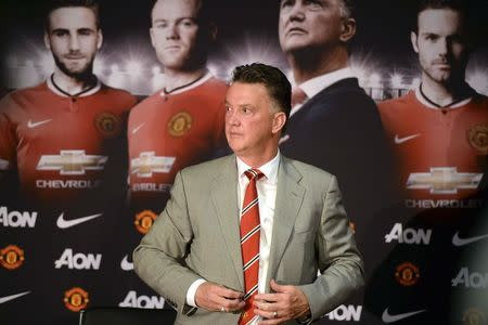 New Manchester United manager Louis Van Gaal attends a news conference at the club's Old Trafford Stadium in Manchester