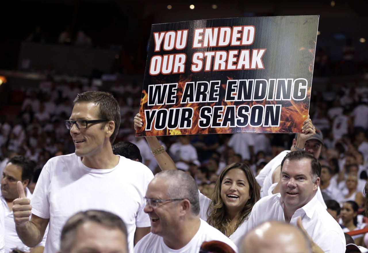 A Miami Heat fan holds up a sign during the first half of Game 5 of an NBA basketball Eastern Conference semifinal between the Heat and the Chicago Bulls, Wednesday, May 15, 2013 in Miami. The Heat defeated the Bulls 94-91, and advance to the conference finals. (AP Photo/Wilfredo Lee)