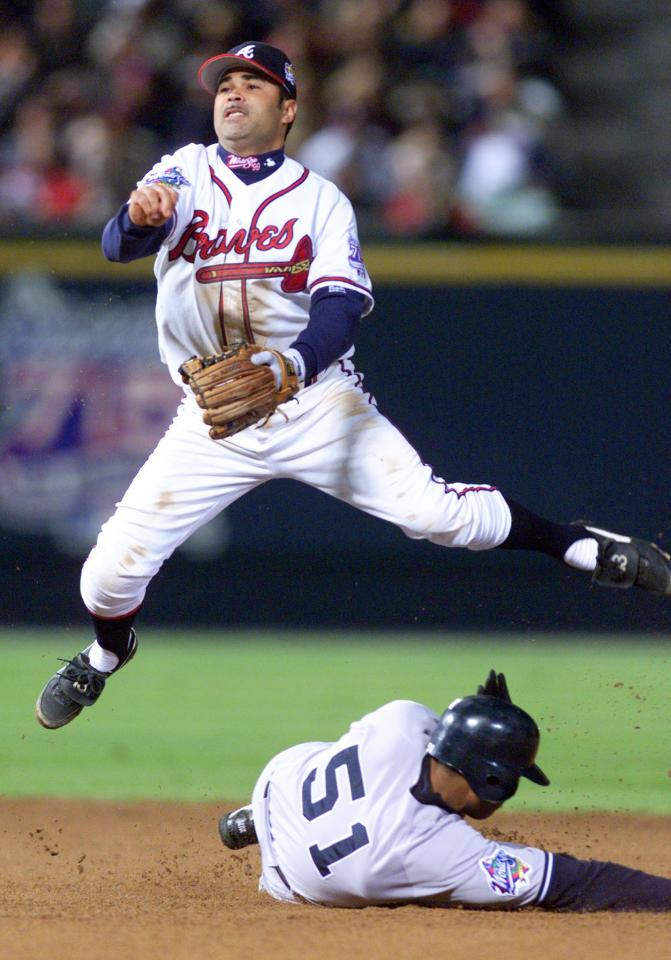 New York Yankees Bernie Williams breaks up an attempt by Atlanta Braves shortstop Ozzie Guillen at a double-play in the sixth inning during Game 2 of the World Series at Turner Field October 24, 1999. Reuters