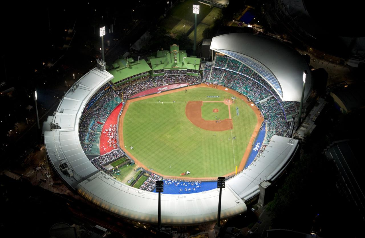 The Sydney Cricket Ground can be seen from above before the start of the opening game of the 2014 Major League Baseball season between the Arizona Diamondbacks and Los Angeles Dodgers March 22, 2014. REUTERS/Destination New South Wales/James Morgan (AUSTRALIA - Tags: SPORT BASEBALL)  ATTENTION EDITORS - THIS PICTURE WAS PROVIDED BY A THIRD PARTY. REUTERS IS UNABLE TO INDEPENDENTLY VERIFY THE AUTHENTICITY, CONTENT, LOCATION OR DATE OF THIS IMAGE. THIS PICTURE IS DISTRIBUTED EXACTLY AS RECEIVED BY REUTERS, AS A SERVICE TO CLIENTS NO ARCHIVES. FOR EDITORIAL USE ONLY. NOT FOR SALE FOR MARKETING OR ADVERTISING CAMPAIGNS