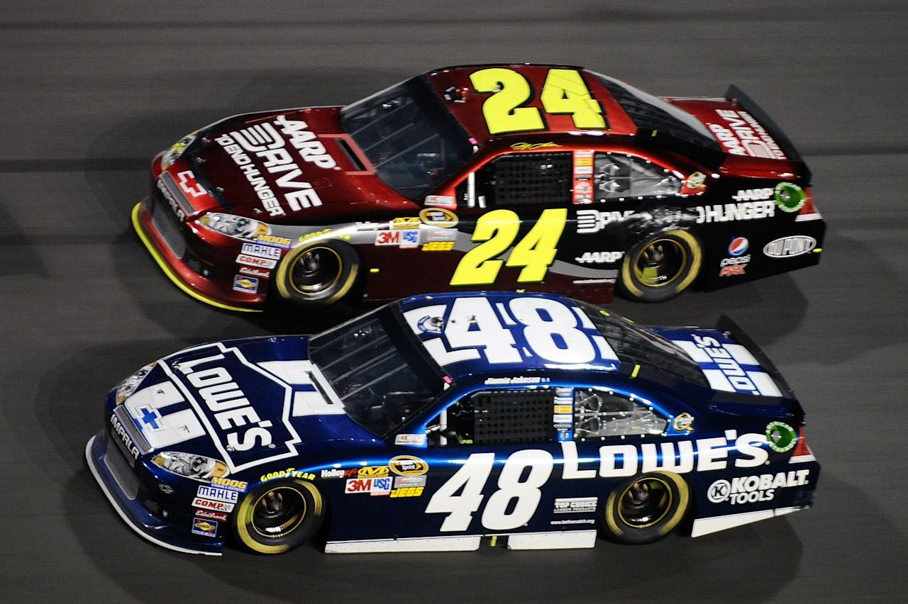 DAYTONA BEACH, FL - FEBRUARY 18: Jimmie Johnson, driver of the #48 Lowe's Chevrolet, and Jeff Gordon, driver of the #24 Drive to End Hunger Chevrolet, race side by side during the NASCAR Budweiser Shootout at Daytona International Speedway on February 18, 2012 in Daytona Beach, Florida.  (Photo by Jared C. Tilton/Getty Images for NASCAR)