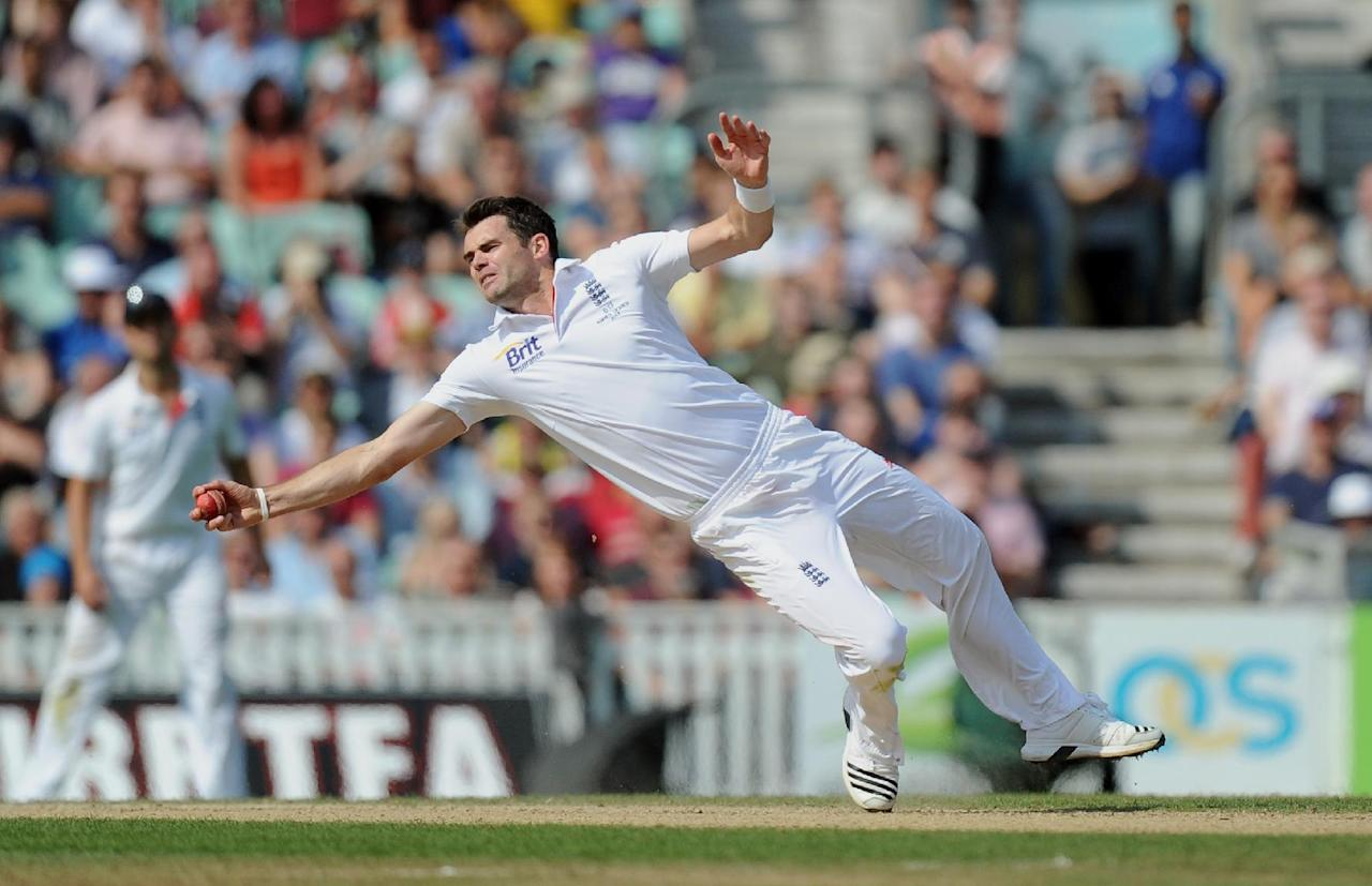England's James Anderson takes the catch of Australia's David Warner off his own bowling during day five of the Fifth Investec Ashes Test match at The Kia Oval, London.