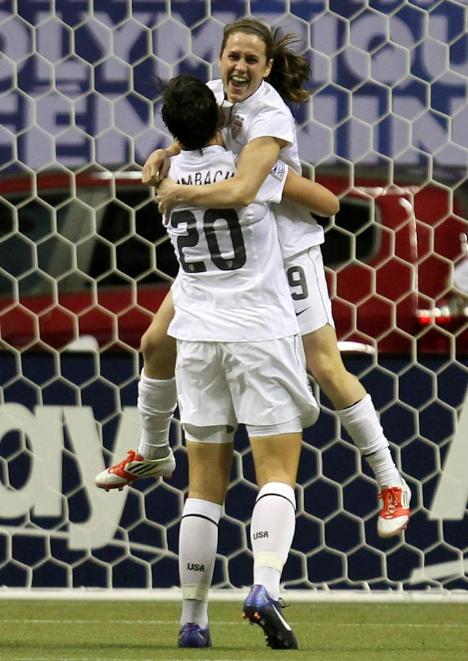 United States' Abby Wambach (20) celebrates her goal with teammate Heather O'Reilly (9) during the first half of a CONCACAF women's Olympic qualifying soccer match against against the Dominican Republic in Vancouver, British Columbia, Friday, Jan. 20, 2012. (AP Photo/The Canadian Press, Jonathan Hayward)