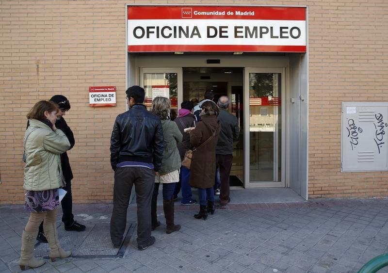 People enter a government-run employment office in Madrid