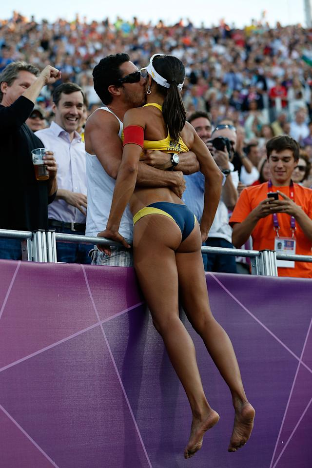 LONDON, ENGLAND - AUGUST 08:  Juliana Silva of Brazil climbs into the crowd as she celebrates winning the Bronze medal in the Women's Beach Volleyball Bronze medal match against China on Day 12 of the London 2012 Olympic Games at the Horse Guard's Parade on August 8, 2012 in London, England.  (Photo by Jamie Squire/Getty Images)
