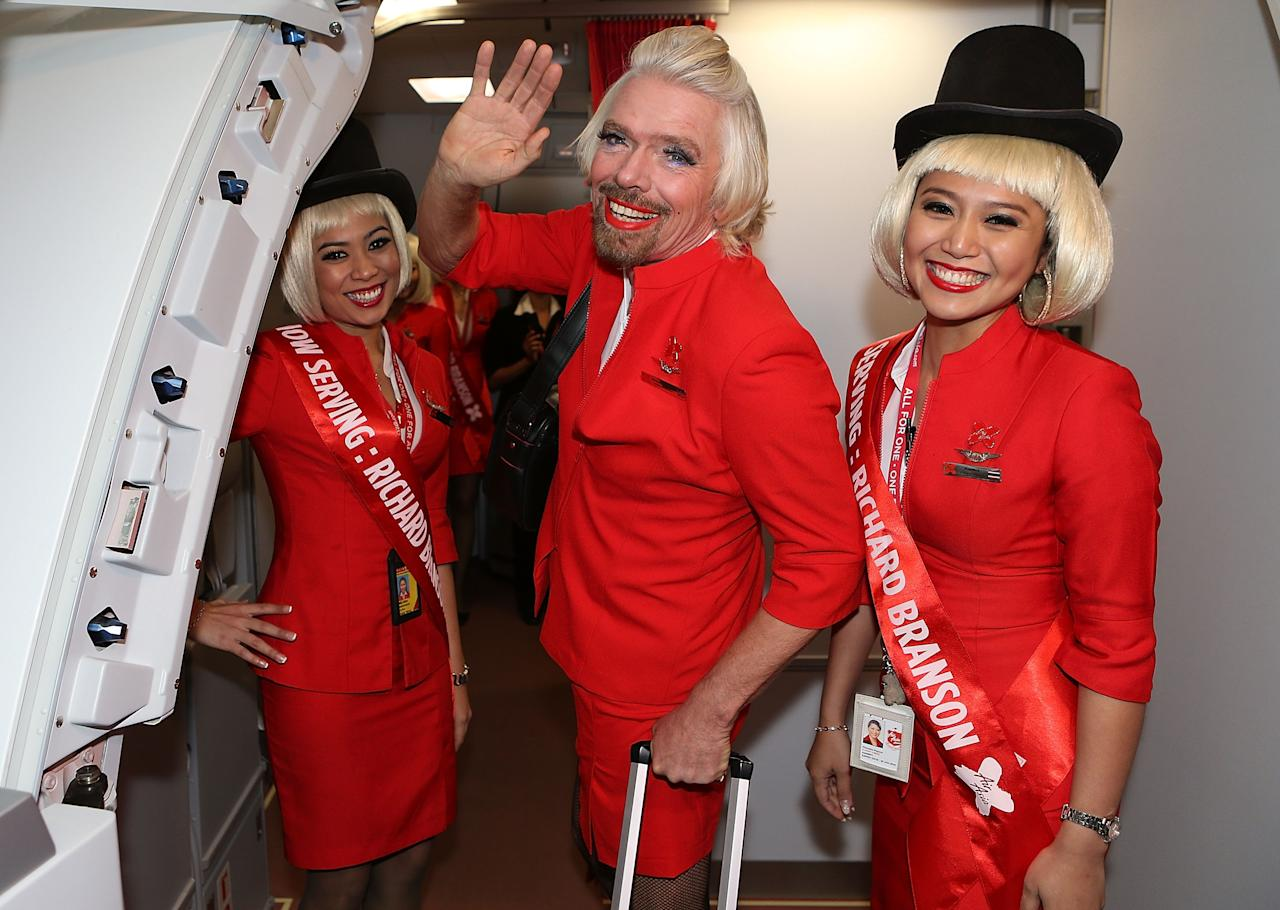 PERTH, AUSTRALIA - MAY 12:  Sir Richard Branson waves farewell prior to his flight to Kuala Lumpur at Perth International Airport on May 12, 2013 in Perth, Australia. Sir Richard Branson lost a friendly bet to AirAsia Group Chief Executive Officer Tony Fernandez after wagering on which of their Formula One racing teams would finish ahead of each other in their debut season of the 2010 Formula One Grand Prix in Abu Dhabi and that the loser would serve as a female flight attendant on board the winner's airline.  (Photo by Paul Kane/Getty Images)