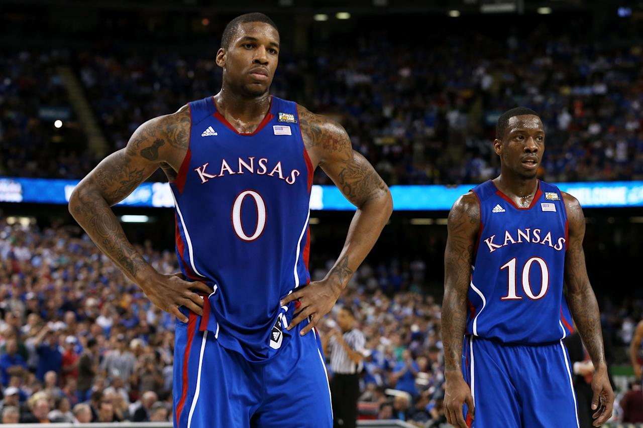 Thomas Robinson #0 and Tyshawn Taylor #10 of the Kansas Jayhawks look on in the first half while taking on the Kentucky Wildcats in the National Championship Game of the 2012 NCAA Division I Men's Basketball Tournament at the Mercedes-Benz Superdome on April 2, 2012 in New Orleans, Louisiana. (Photo by Jeff Gross/Getty Images)
