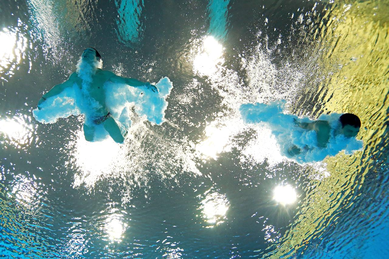 LONDON, ENGLAND - AUGUST 01:  (L-R) Kai Qin and Yutong Luo of China compete in the Men's Synchronised 3m Springboard final on Day 5 of the London 2012 Olympic Games at the Aquatics Centre on August 1, 2012 in London, England.  (Photo by Clive Rose/Getty Images)