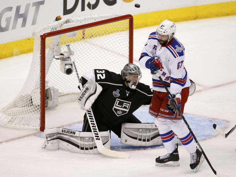 Kings goalie Quick makes a save as Rangers' Pouliot attempts to screen him during the second period in Game 1 of their NHL Stanley Cup Finals hockey series in Los Angeles