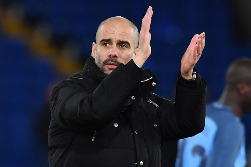 Manchester City's Spanish manager Pep Guardiola applauds at the end of the English FA Cup fourth round football match against Crystal Palace January 28, 2017