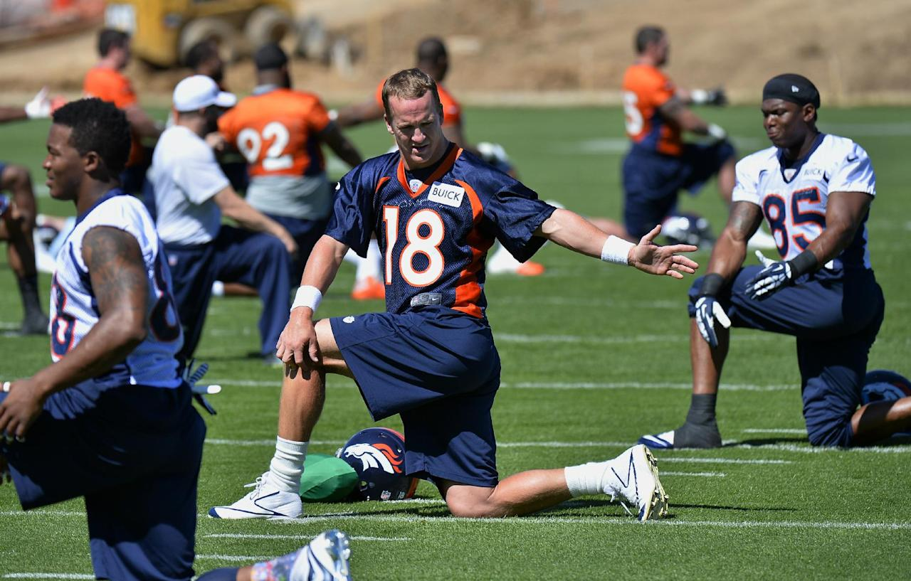 Denver Broncos' Peyton Manning stretches during an NFL football organized team activity, Wednesday, May 28, 2014, in Englewood, Colo. (AP Photo/Jack Dempsey)