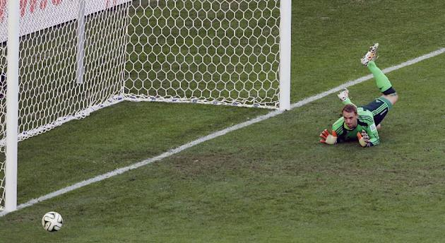 Germany's goalkeeper Manuel Neuer eyes the ball as it goes out after a shot by Argentina's Gonzalo Higuain, not seen, during the World Cup final soccer match between Germany and Argentina at the Maracana Stadium in Rio de Janeiro, Brazil, Sunday, July 13, 2014. (AP Photo/Hassan Ammar)