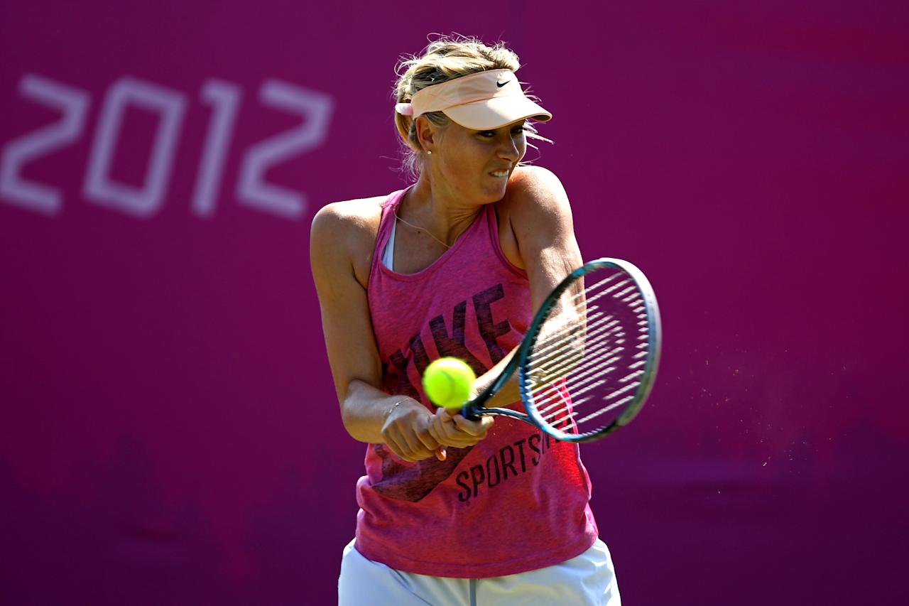 LONDON, ENGLAND - JULY 26:  Maria Sharapova of Russia plays a backhand during the practice session ahead of the 2012 London Olympic Games at the All England Lawn Tennis and Croquet Club in Wimbledon on July 26, 2012 in London, England.  (Photo by Clive Brunskill/Getty Images)