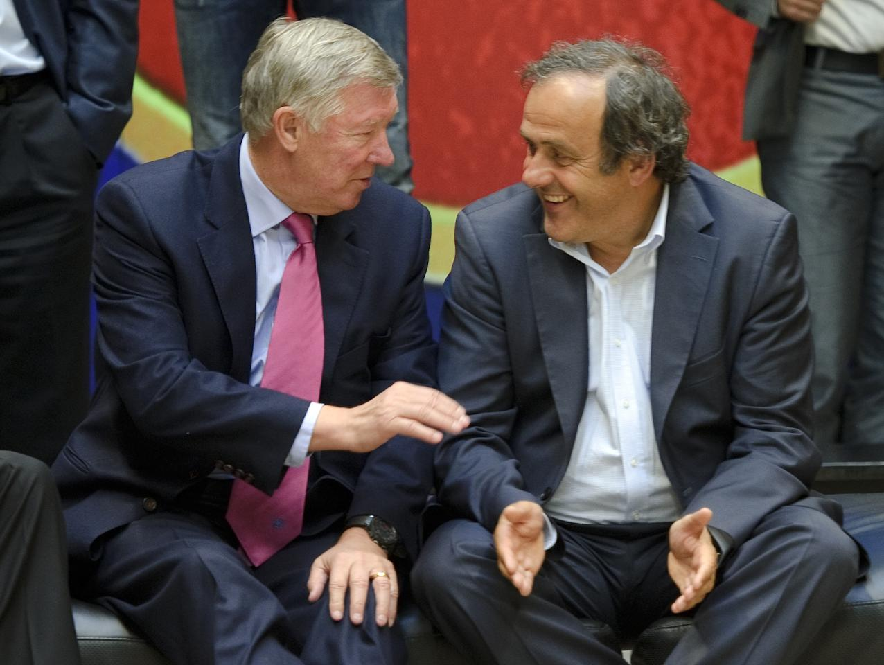 UEFA president Michel Platini (R) talks with Manchester United's manager Alex Ferguson as they pose for a group picture, at the 13th Elite Club Coaches Forum, in Nyon, on August 31, 2011. Europe's leading club coaches are invited at the event to discuss the latest trends in club football and express their views on major issues affecting top club football.  AFP PHOTO / FABRICE COFFRINI (Photo credit should read FABRICE COFFRINI/AFP/Getty Images)
