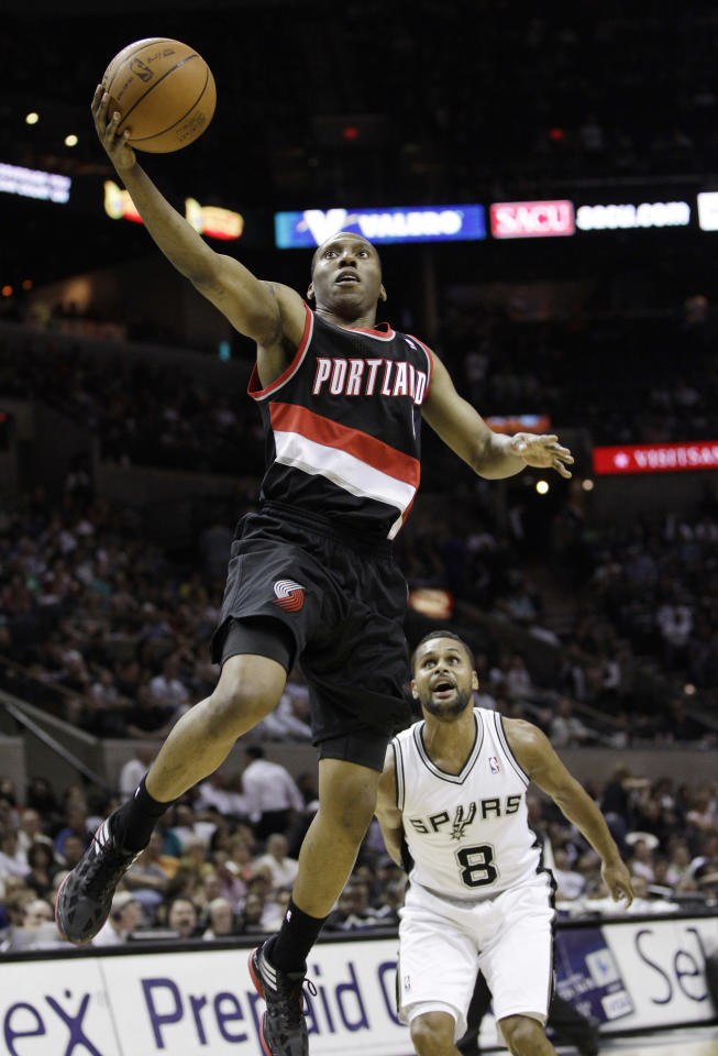 Portland Trail Blazers' Nolan Smith, left, shoots as San Antonio Spurs' Patty Mills defends during the fourth quarter of an NBA basketball game, Monday, April 23, 2012, in San Antonio. San Antonio won 124-89. (AP Photo/Eric Gay)