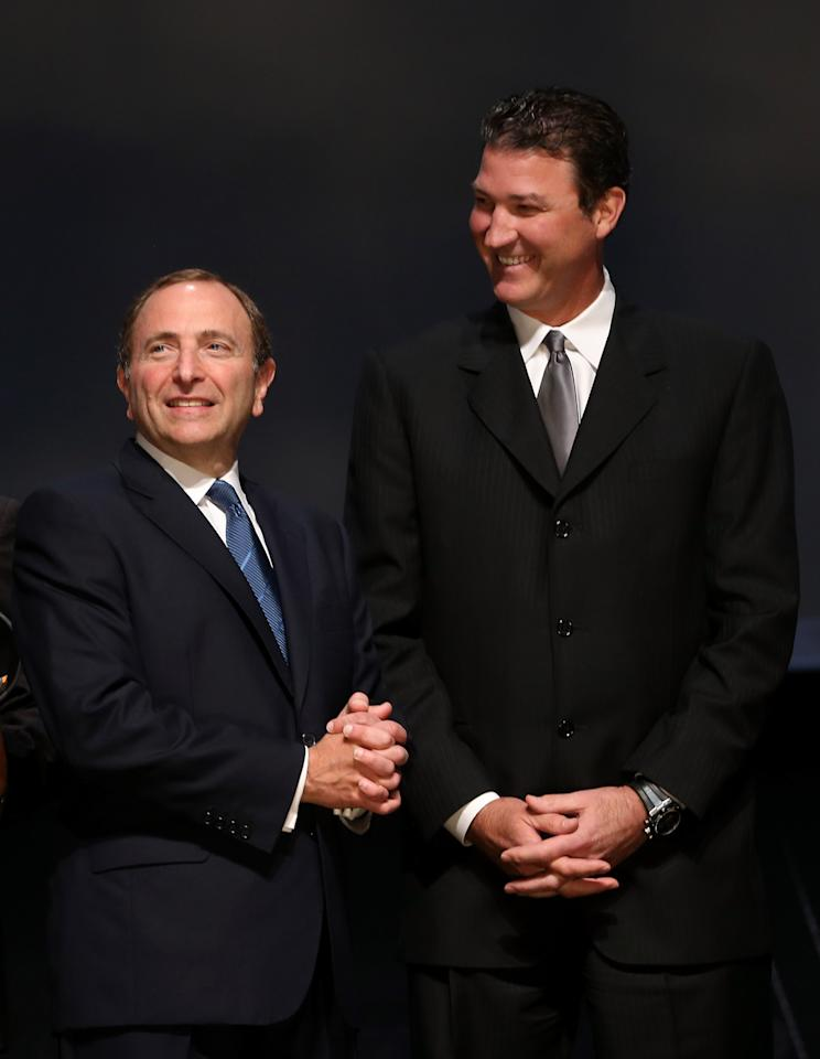 PITTSBURGH, PA - JUNE 22:  NHL Commissioner Gary Bettman (L) speaks with Co-Owner of the Pittsburgh Penguins Mario Lemieux during Round One of the 2012 NHL Entry Draft at Consol Energy Center on June 22, 2012 in Pittsburgh, Pennsylvania.  (Photo by Bruce Bennett/Getty Images)