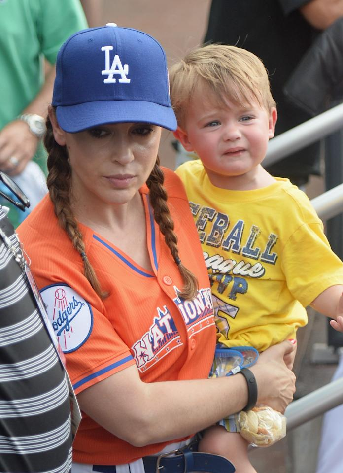 NEW YORK, NY - JULY 14: Actress Alyssa Milano (L) and son Milo Thomas Bugliari attend the Taco Bell All-Star Legends & Celebrity Softball Game at Citi Field on July 14, 2013 in New York City. (Photo by Mike Coppola/Getty Images)