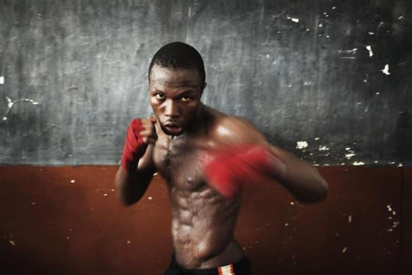 Olympic hopeful Abdul Rashid Bangura, 27, shadow boxes while training at the national stadium in Sierra Leone's capital Freetown, April 25, 2012. Sierra Leone's national boxing team was scrambling on Wednesday to raise money to send athletes to an Olympic qualifying event starting in Morocco on Friday, but lack of financing and government support means the competition is likely out of reach for most of the national team.