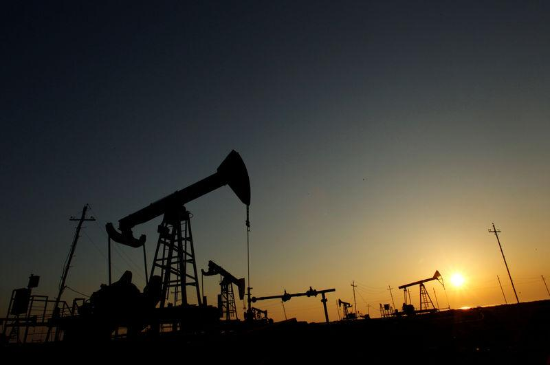 Oil falls on bulging US crude inventories, record global supplies