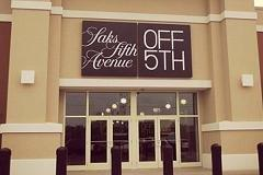 As luxe outlets go online, off-price wars heat up